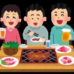 焼肉を食べる男女